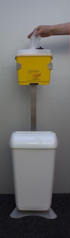 Alcohol doekjes dispenser op statief met afvalbak wit Image